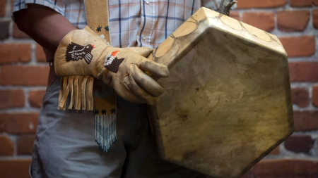 Hand made gloves and traditional drum