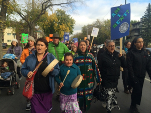 First Nations women marching.