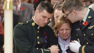 Two soldiers and a crying woman.