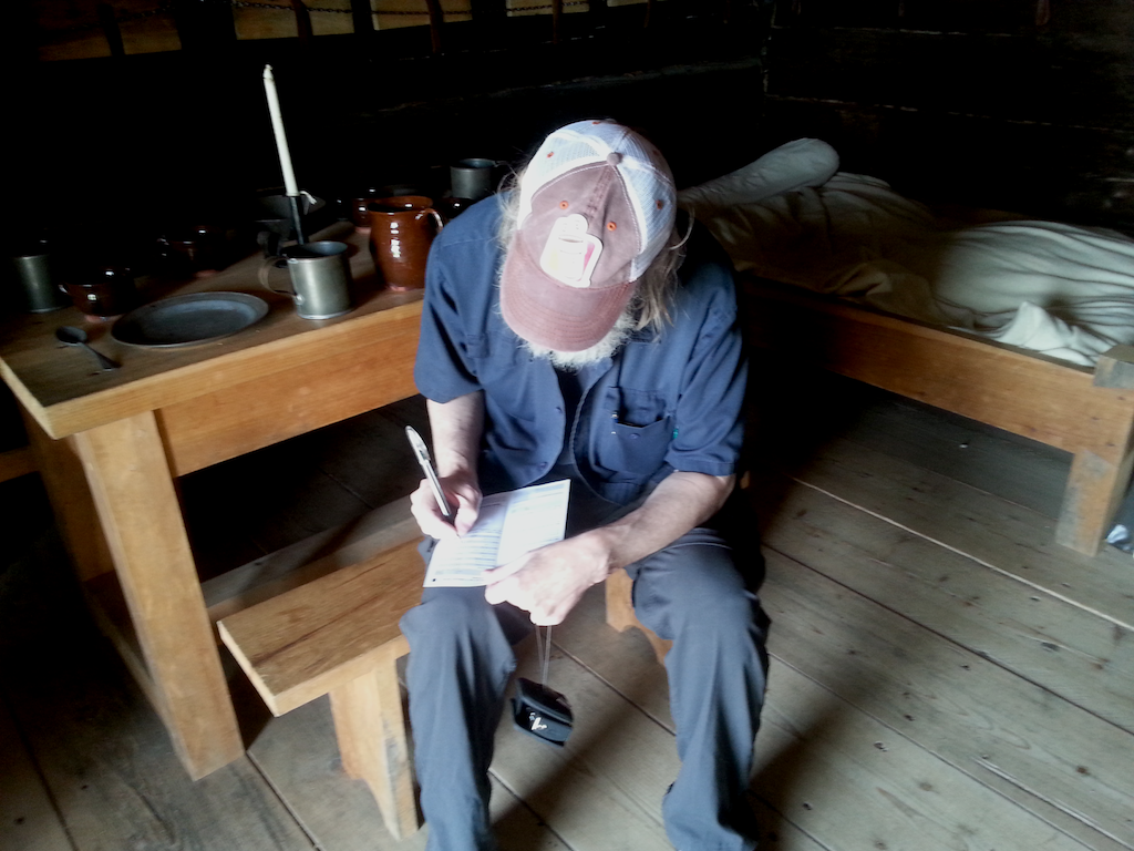 Jim Filliing out a form inside the blochouse at St Andrews by the Sea.