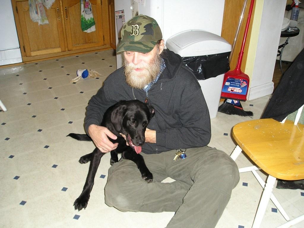 Jim on the floor with Jassper.